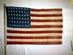 U.S. flag, 48 stars.